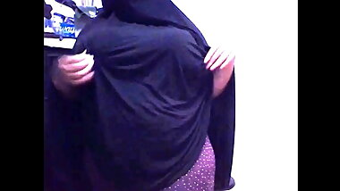Arab girl with a big ass wearing a Niqab shows big boobs
