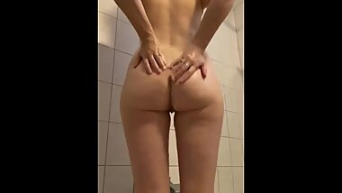 Soaping up her big ass in the shower